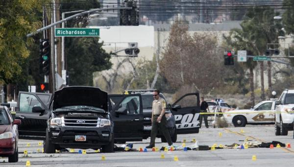 Dec. 3, 2015 - San Bernardino, California, U.S. - Police officers investigate the site of last night shootout along E. San Bernardino Ave., in San Bernardino. Multiple attackers opened fire on a banquet at a social services center for the disabled in San Bernardino on Wednesday in San Bernardino. (Credit Image: © Ed Crisostomo/The Orange County Register via ZUMA Wire)